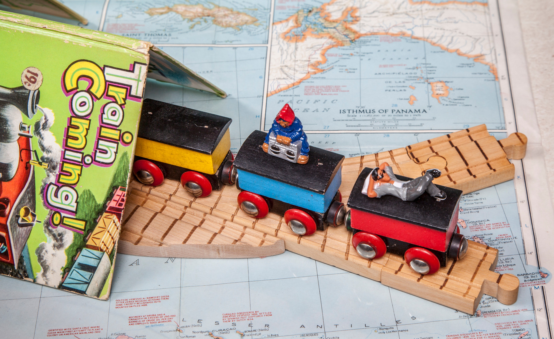 Close-up of train's start in Honduras with Homies figures riding on train tops.