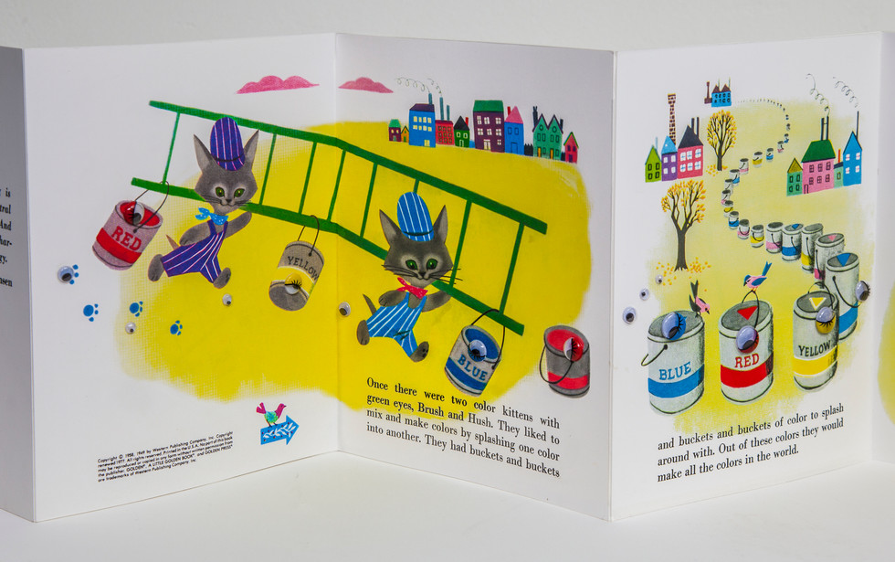 "Three-page spread in altered book. Original illustration and text with addition of plastic ""googly eyes,"" gradated in size and color to accentuate linear progression of story continues throughout book."