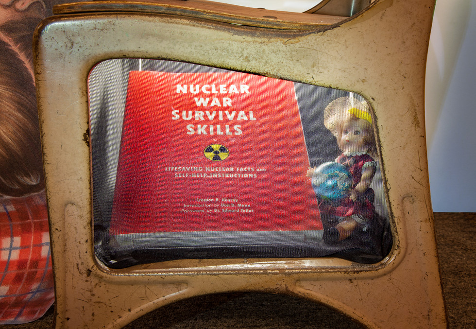 (desk cubby) Nuclear War Survival Skills: Lifesaving Nuclear Facts and Self-Help Instructions, Cresson H. Kearny, contemporary; vintage plastic doll holding globe.