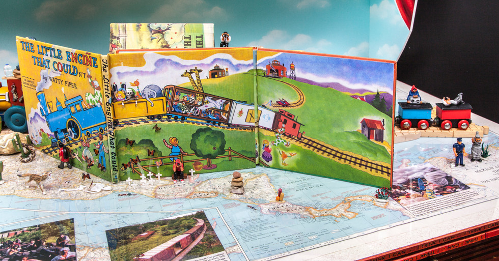 The next 5 images, with close-ups, follow the little boy's train journey from its start, downstage right, in Honduras, to its end, upstage left, in America. Details on map include crosses representing migrant deaths in Chiapas and migrating Monarch butterflies in Michoacán.