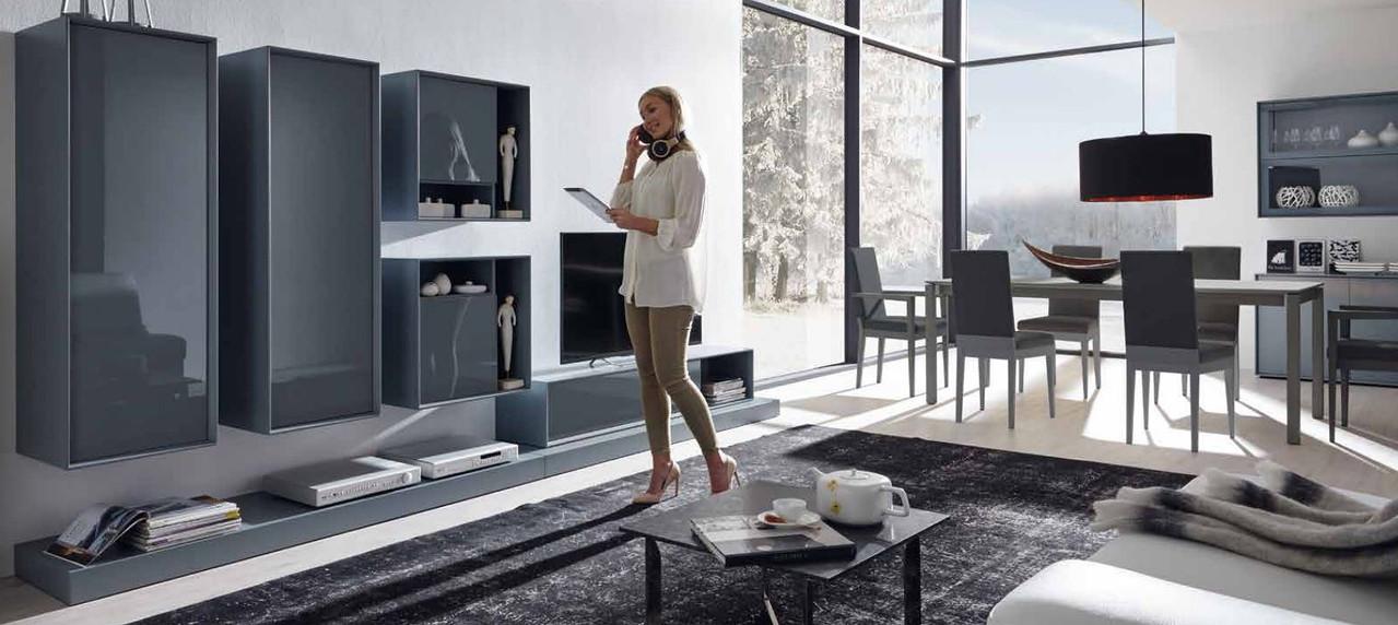 Woman listens music in living room loft