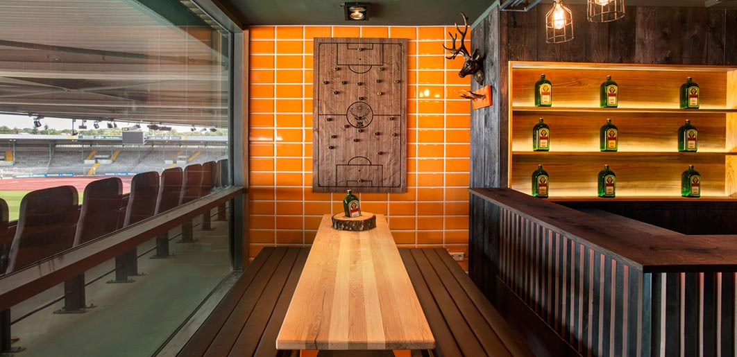 Orange tiled locker room inspired stadium bar