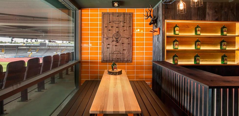 Orange tiled locker room inspired stadium bar