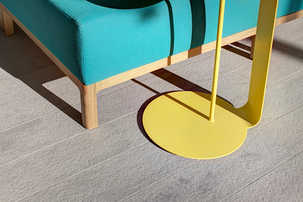 Wooden legs detail of sofa and steel couch table