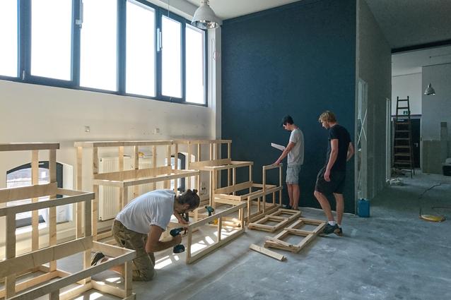 Carpenters build office arena