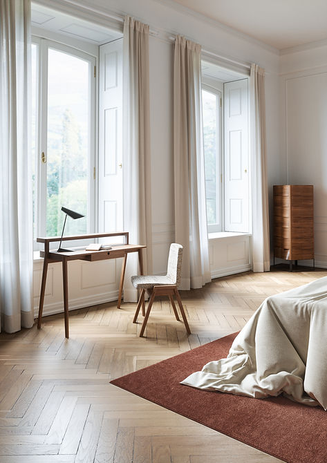 Home office in bedroom by the window by