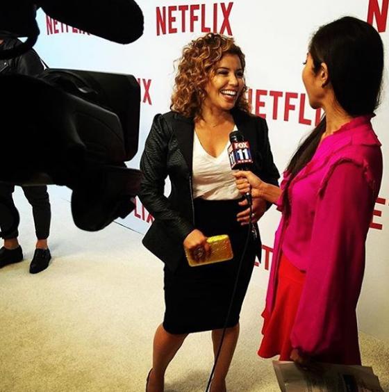 Justina Machado wearing Jean Paul Ataker at a Netflix premiere