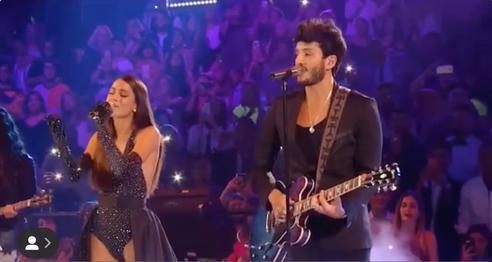 Tini with Sebastian Yatra performing at Premios Juventud