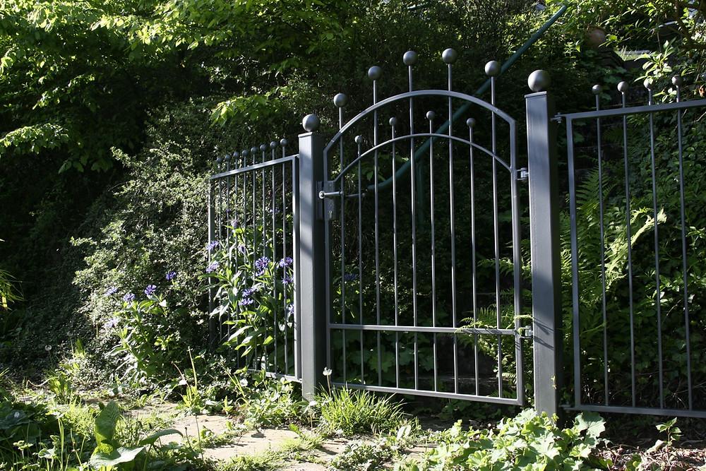Iron gate in a lush environment