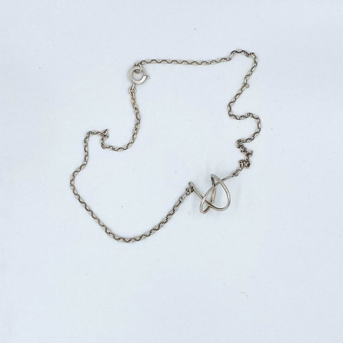Handcrafted silver love knot necklace