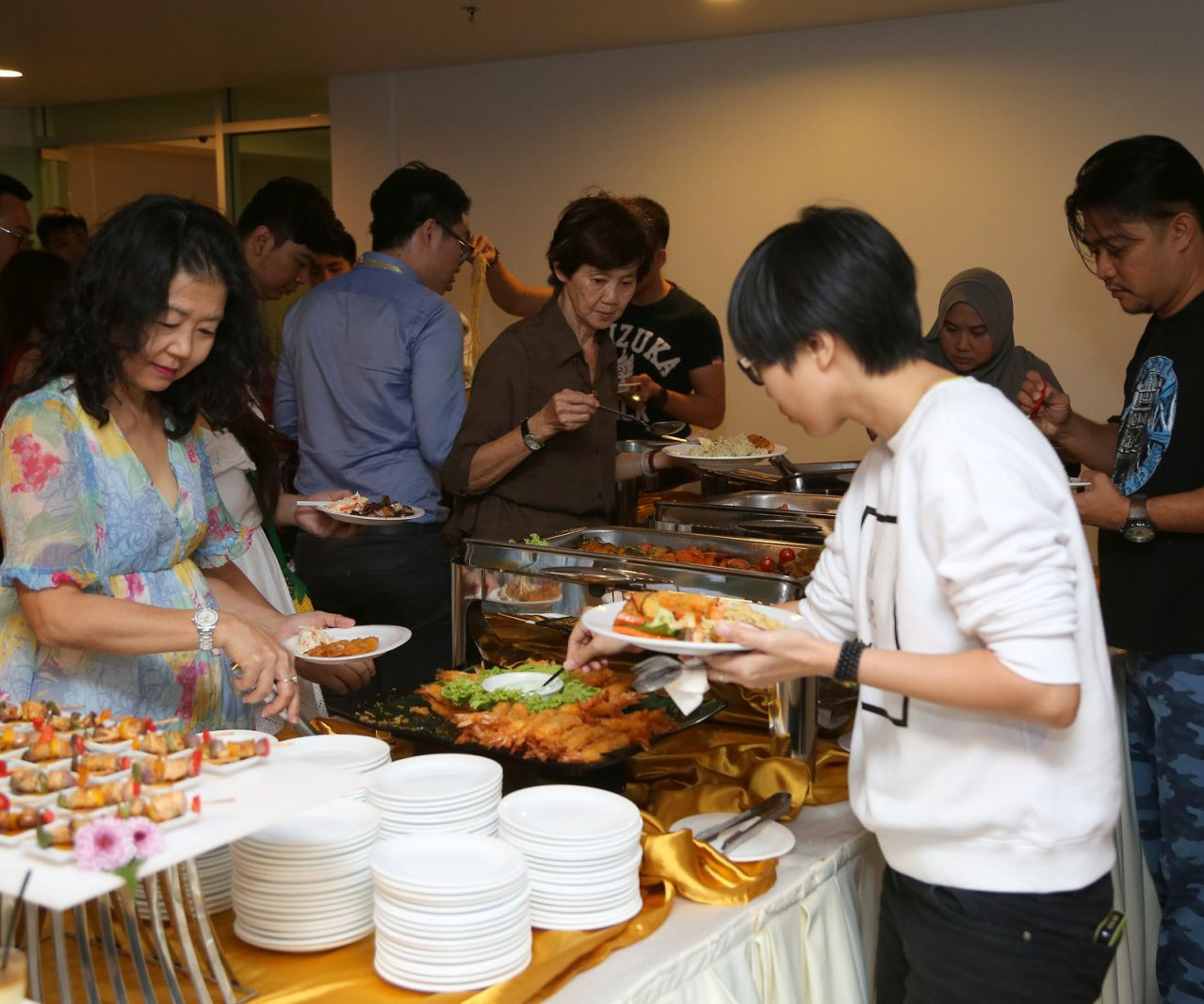 Guests enjoying a sumptuous dinner spread.