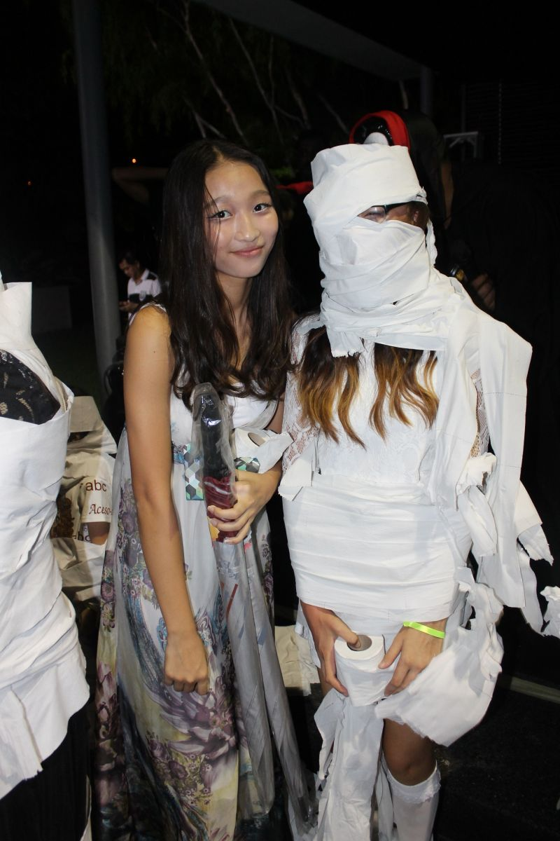 Residents posing in their 'new costume' after enjoying the Creepy Mummy Wrap game.
