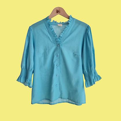 Blue ruffled blouse