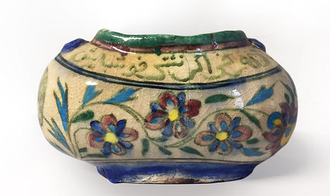 Ceramic Kashkul with polychrome glaze and inscription, Iran, later C.19th