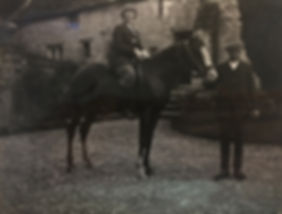 Dorothy Walker seated on Astola, 1924