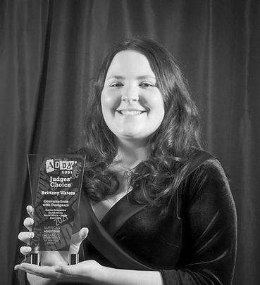 Image of Müde Studios owner smiling and holding a trophy.