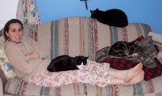 Butters (striped) & Lucy (black/white) both passed last year.  Dizzy (black) is still going strong.  Mom Jen enjoying kitty love.