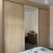 Mirrored wardrobe with shelves