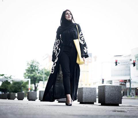 Lady in abaya walking in town