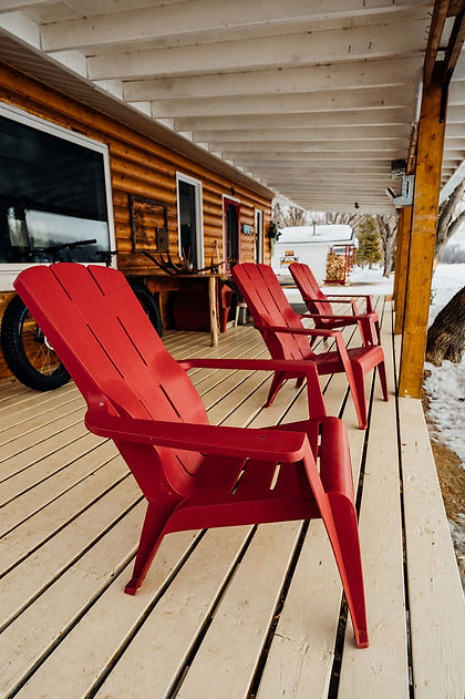 Red chairs outside of Aski Holistic Adventures