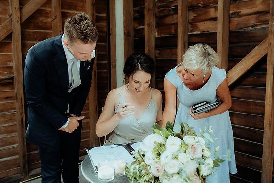 Bridesmaids signing register .jpg