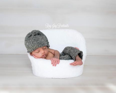 gray and white simple newborn photo