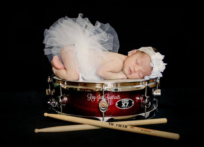 newborn on drum