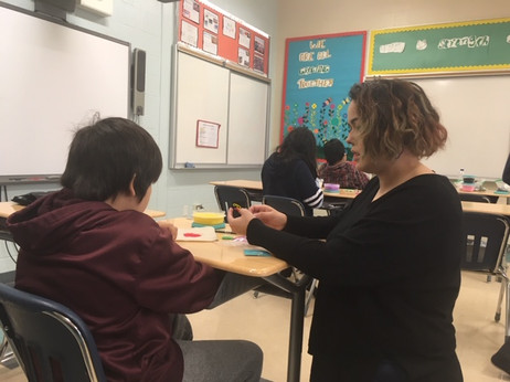 Emma working with a Grade Five student in Attawapiskat