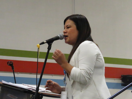 Krystle singing at the Great Moon Gathering in Timmins, Ontario
