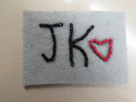 Initials of Korean pop star Jungkook - student beadwork from Moose Factory
