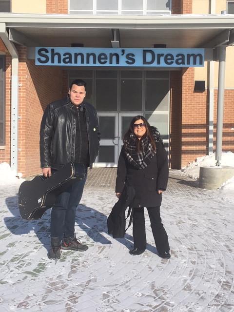 Krystle and Lance in front of Kattiwapiskak Elementry School