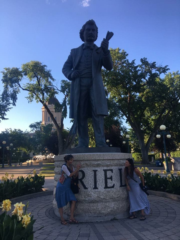 Kim and Krystle at the Louis Riel statue in Winnipeg