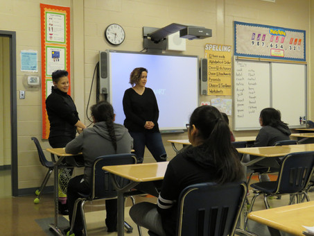 Emma and Heather introducing their beading workshop to a Grade 5 class in Attawapiskat
