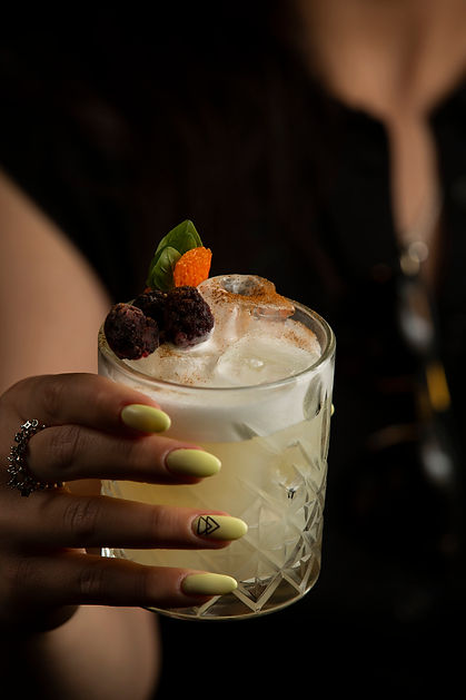 woman-holding-glass-cocktail-garnished-w