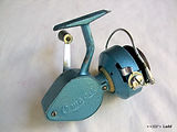 Alpha Blue Omega all metal body vintage fishing reel