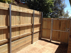 Timber Fence with Retaining Wall