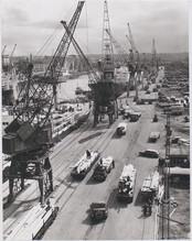 A Ship Unloading Timber