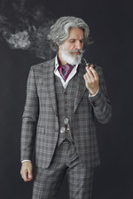 elegant-senior-man-with-a-smoking-pipe-J