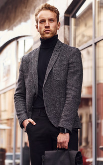 man-in-elegant-formal-wear-and-with-bag-