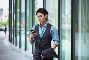 businessman-wearing-blue-shirt-and-vest-