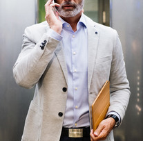 mature-businessman-with-smartphone-in-th