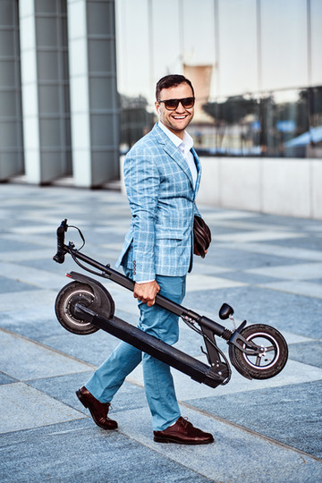 elegant-man-is-holding-electro-scooter-L