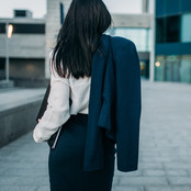 businesswoman-with-suit-in-hand-back-vie