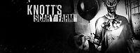 Knotts-Scary-Farm-clown-holding-balloon.