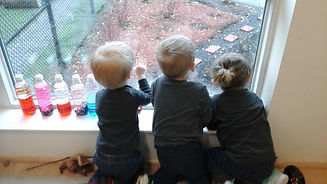 children looking out the window into the gardens of Nanabijou Child Care Centre