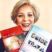 Author and world traveler Diann Schinder holds up her two books.