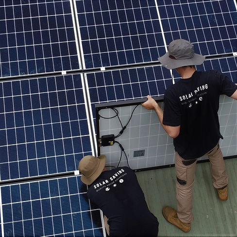 Solar Saving quality solar installers laying pv panels on roof
