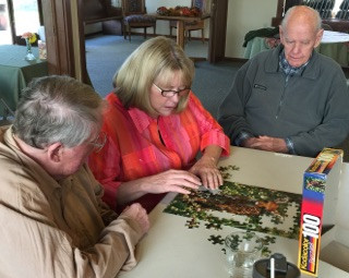 People putting a puzzle together