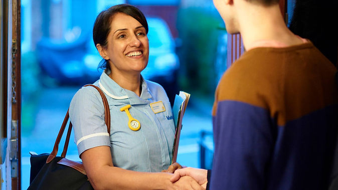 smiling-nurse-at-the-door-in-summer-larg