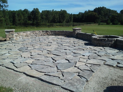 Relax By The Fire Pit On Your New Flagstone Patio